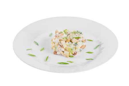 salad with mushrooms, honey mushrooms, cucumber, potato, bell pepper, sour cream, mayonnaise, garnished with green onions on plate, side view white isolated background Imagens