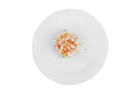 salad with corn, cucumber, meat, egg, mayonnaise, sour cream, garnished with bell pepper, potatoes on plate, view from above, white isolated background Stock fotó