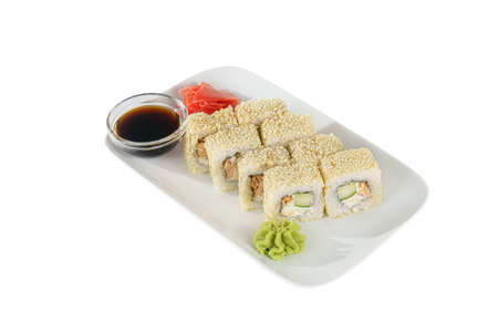 Sushi, rolls, uramaki Alaska, with avocado, cucumber, crab meat, raw seafood, soy sauce, marinated ginger and wasabi. Food on plate, white isolated background side view