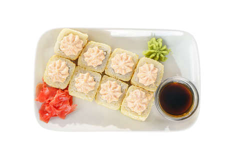 Sushi, rolls, uramaki, Alaska, tempura with lava sauce, tobiko caviar, raw seafood, soy sauce, marinated ginger and wasabi. Food on plate for the menu, white isolated background, view from above Imagens