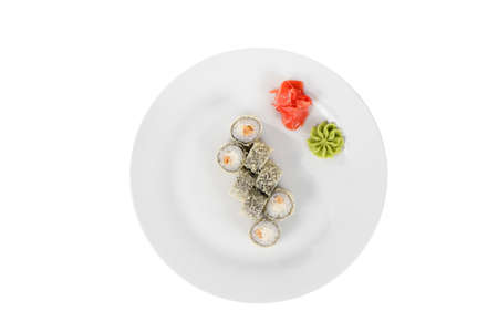 Sushi, rolls, uramaki Alaska, with meat, cheese, marinated ginger and wasabi, white isolated background view from above