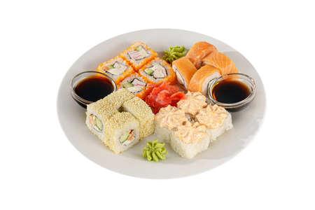 Set of sushi, rolls, uramaki, hosomaki california and philadelphia, lava sauce, marinated ginger and wasabi, white isolated background, side view