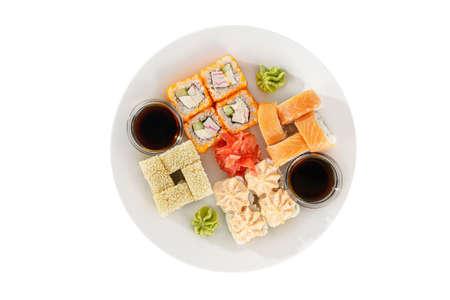 Set of sushi, rolls, uramaki, hosomaki california and philadelphia, lava sauce, marinated ginger and wasabi, white isolated background, view from above