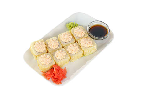 Sushi, rolls, uramaki, Alaska, tempura with lava sauce, tobiko caviar, raw seafood, soy sauce, marinated ginger and wasabi. Food on plate for the menu, white isolated background, side view