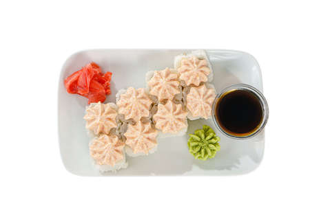 Sushi, rolls, uramaki, alaska, with lava sauce, tobiko caviar, raw seafood, soy sauce, marinated ginger and wasabi. Food on plate for the menu, restaurant, white isolated background, view from above