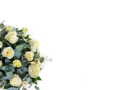 Bouquet of white roses, eucalyptus and Ruscus, view from above, a holiday, a gift for a woman, mom, postcard, free space, on a white isolated background Stock fotó