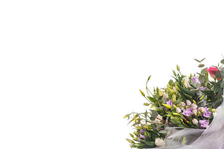 Bouquet of lilac, violet, eustoma and eucalyptus, delicate and lightweight. A holiday, a gift for a woman, mom, postcard, free space on a white isolated background, side view Imagens