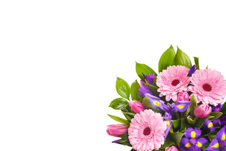 Bouquet of pink gerberas, violet irises and pink, crimson tulips on a white isolated background, view from above. A holiday, a gift for a woman, mom, postcard, free space