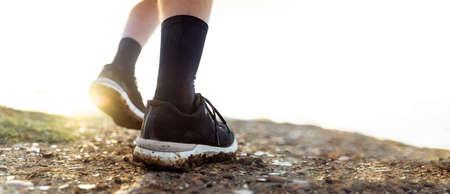 Man legs in sport footwear low angle Standard-Bild