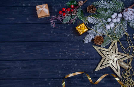 banner postcard with a decor on a Christmas tree with cones ornament a gold serpentine with a star on New Year's holiday on a wooden board