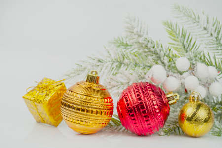 beautiful background postcard with Christmas balls ornament decorations near a  Christmas tree for Christmas winter on a bokeh background