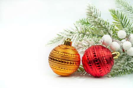 beautiful background postcard with Christmas balls ornament decorations near Christmas tree for Christmas winter on a bokeh background