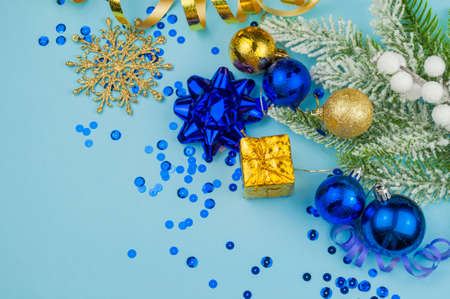 Christmas banner with blue and gold ornament decoration with Christmas tree snowflakes and serpentine for New Year holiday in winter in December