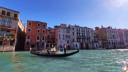 Venice Italy -  10  October 2019. Panorama of a beautiful view of the Grand Canal with houses with a gondola boat.