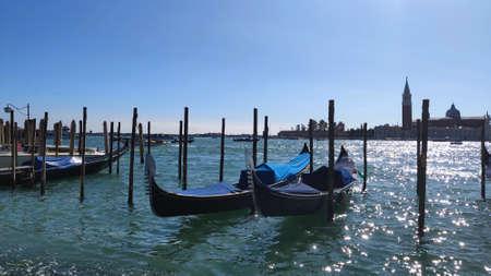 Venice, Italy coastal view of piazza san marco venice italy with gondola boats on the shore