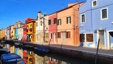 Venice Italy Burano . City view island with colorful houses in with boats