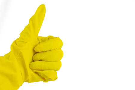 man's hand in latex glove for cleaning and disinfection shows super gesture on isolated white background