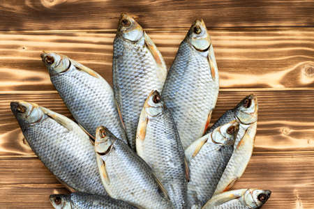 dry fish on a wooden background with space for text Stockfoto