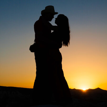 hug of two lovers on a background of a fiery sunset