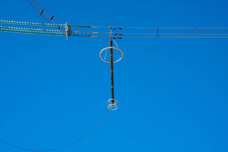 metal supports transmit electricity on the sky background Stock Photo