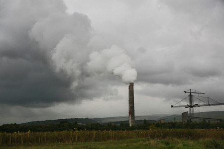 dirty gray smoke from industrial chimney against the sky Stock Photo