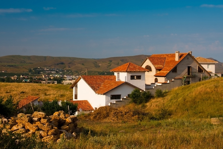 landscape with a beautiful house on the outskirts of town Stock Photo