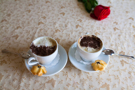a delicious cappuccino in a white cup on the table Stock Photo