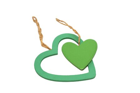 Two green hearts from wood isolated on white background photo