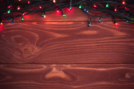 ?text space?: Christmas rustic background - vintage planked wood with lights and free text space