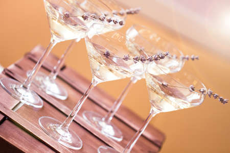 vesicles: Glasses of with white champagne decorated with lavender on blurred background. DOF Stock Photo