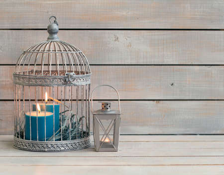 blue candles: Lantern and blue candles over white wooden background. Copy space. Stock Photo