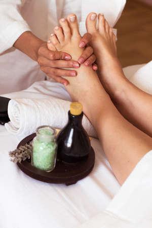 Massage of human foot in spa salon - Soft focus image Reklamní fotografie - 47516305