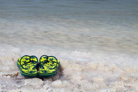 dead sea: View of Dead Sea coastline. Slippers on the shore