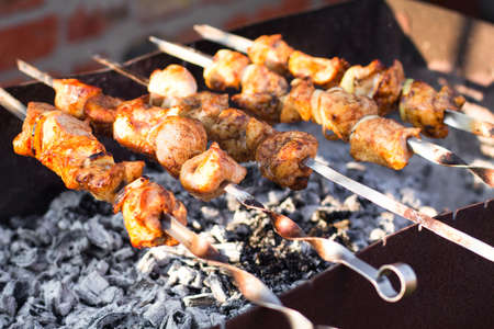 meat skewers: Smoky grilled marinated meat skewers Chicken. Close up
