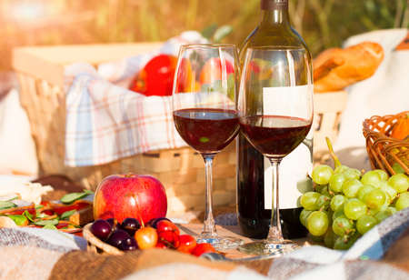 party wine: Two glasses of the red wine, picnic theme Stock Photo