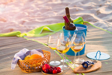 Glasses of the white wine on the beach, picnic theme
