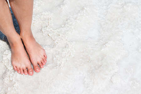 salt water: The lake with salt water. Baskunchak . Feet on the shore