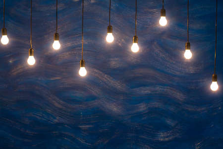 textural: Light bulbs on blue textural background Stock Photo