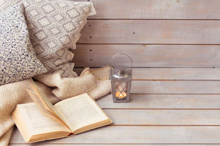 Christmas Lanterns and open book on wooden background. Copy space.