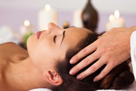 massage: Pretty woman relaxing in the beauty treatment. Facial massage. Spa, resort, beauty and health concept