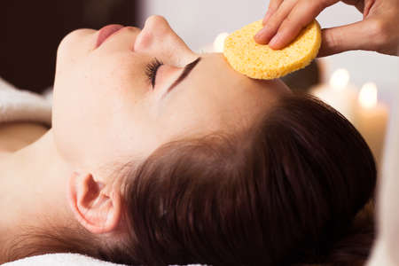 treatment: Relaxed woman with a deep cleansing nourishing face mask applied to her face. Spa treatment Stock Photo