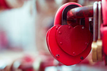 padlock: Vintage colorful padlocks heart shaped on blurred background, symbol of love Stock Photo