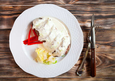 sause: Delicious beef steakes with  sweet pepper and white sause on wooden background. Top view Stock Photo