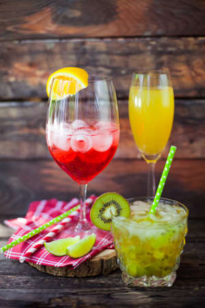 champaigne: Summer cocktail on a rustic wood background Stock Photo