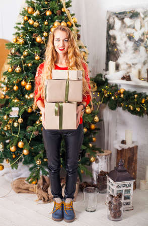 blondy: Portrait of happy young blondy woman with many christmas present box, at a Christmas decorations Stock Photo