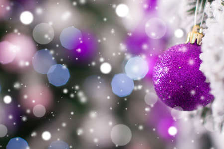 holyday: Christmas ball hanging on a frosty tree in the snow. Winter holyday background Stock Photo