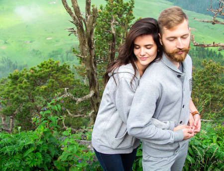 Happy Smiling Couple in love, beautiful couple embraces in mountains