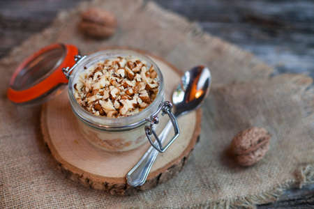 Homemade yogurt with granola, dried fruit and nuts .