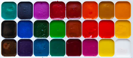 Top view of watercolor paints in box isolated on white background, close up. Stock Photo