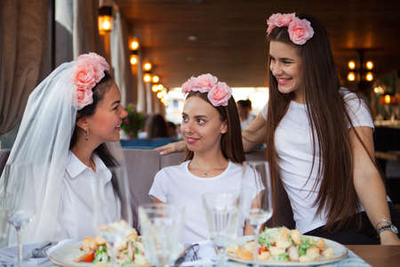 Three beautiful happy women at hen party, girls celebrating a bachelorette party of bride